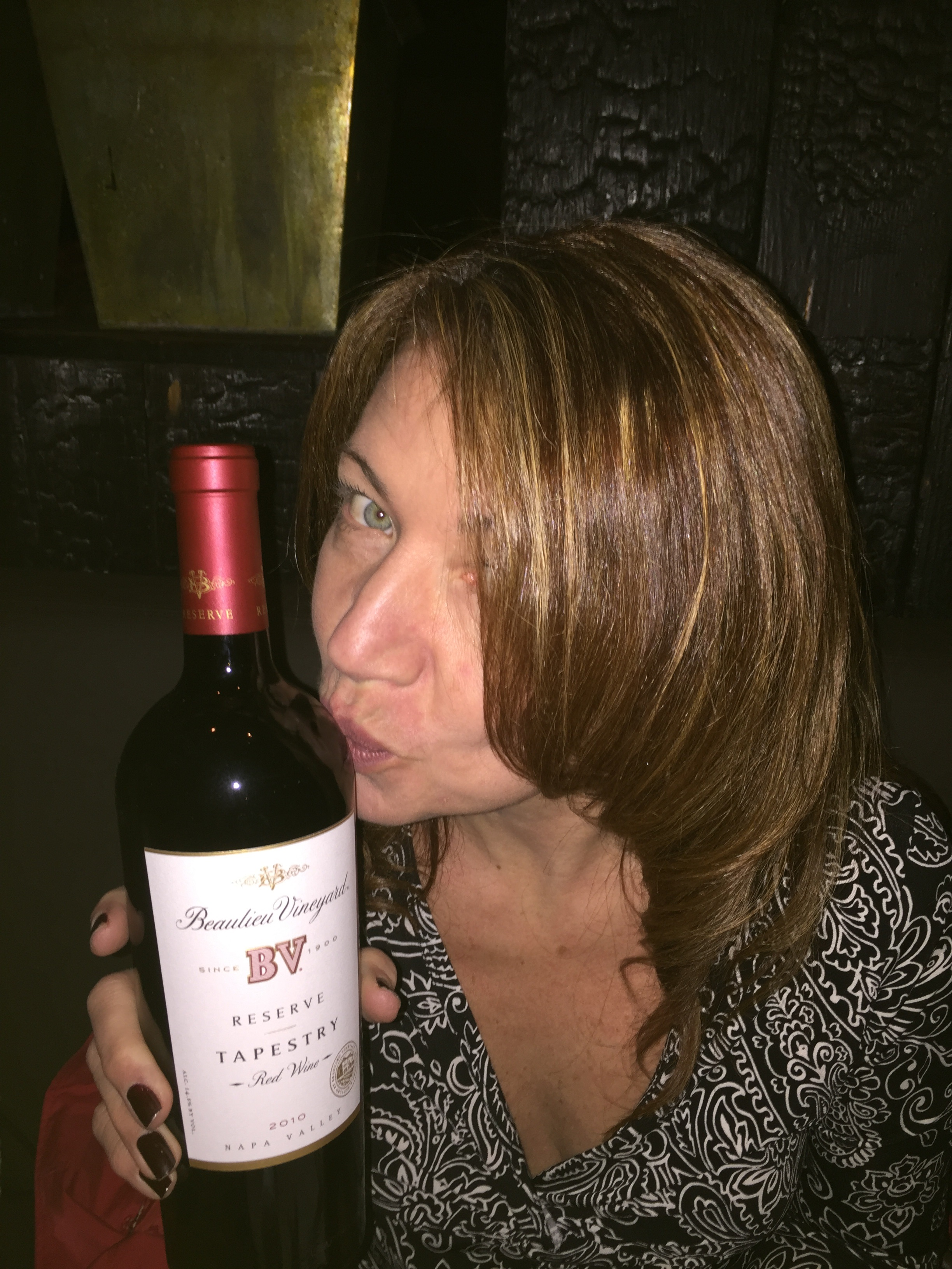Kissing a Wine Bottle